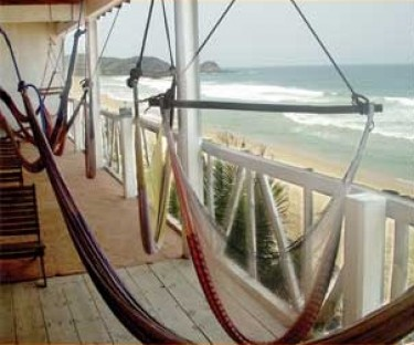 Relax on your balcony overlooking the beach